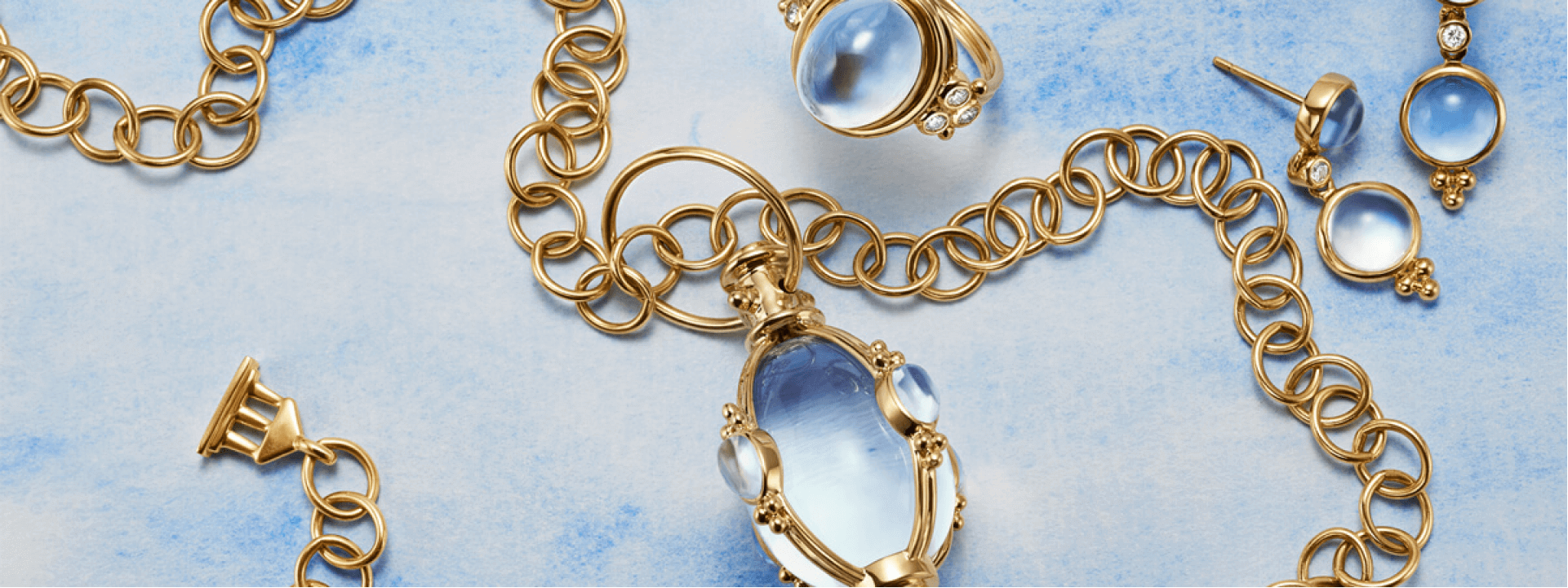 Luxury jewelry on blue textured background
